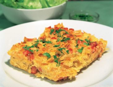 Ham Pasta (Schinkenfleckerl) covered with baked cheese
