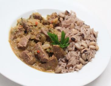 Jamaikanisches Lammcurry in Rumsauce