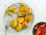 Knusprige Reislaibchen mit Käsekruste und Tomatensalat